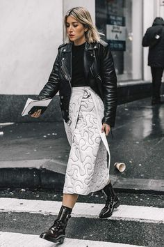 How to style an elegant midi skirt with an edgy leather jacket ensemble