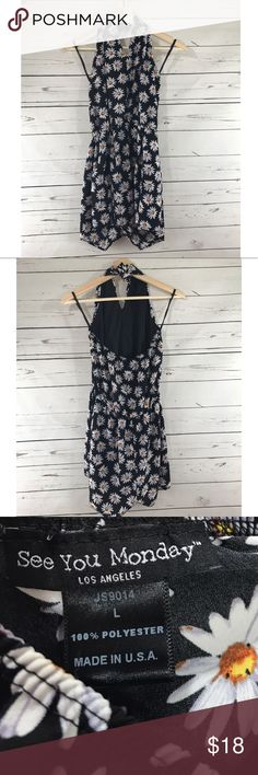 """Daisy Halter Top Romper Size L Super cute Romper with daisy floral print size Large. In great preworn condition. Perfect for spring and summer. Measurements taken laying flat- armpit to armpit 14"""" and top to bottom hem is 28"""" Sorry, were unable to model this. no trades. See You Monday Pants Jumpsuits & Rompers"""