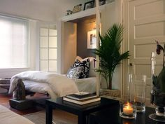 The cozy alcove in this contemporary bedroom resembles a permanent version of a Murphy bed. The nook is painted a smoldering gray to contrast with the surrounding white walls. Contemporary Murphy Beds, Contemporary Bedroom, Bed Nook, Closet Designs, Cool Beds, Living Room Bedroom, Living Rooms, Spare Room, Portfolio Design