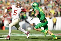 Quarterback Jameis Winston #5 of the Florida State Seminoles runs from an Oregon Ducks defender during the first quarter of the College Football Playoff Semifinal at the Rose Bowl Game presented by Northwestern Mutual at the Rose Bowl on January 1, 2015 in Pasadena, California. (Dec. 31, 2014 - Source: Ezra Shaw/Getty Images North America)