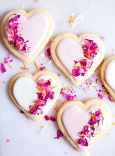 I've decided that the only thing better than actually receiving flowers, is eating them! So for Valentine's Day, I set out to make a lemony sugar cookie, coated with just a hint of pink icing and decorated with a sprinkle of vibrant, edible flowers! Best Sugar Cookie Recipe, Lemon Sugar Cookies, Cookie Recipes, Cookie Ideas, Cookies Fondant, Baby Cookies, Heart Cookies, Cupcakes, Pink Cookies