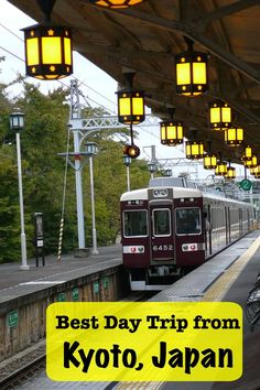 The best day trip from Kyoto, Japan is reached by this lantern lit train station in Arashiyama.