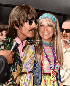 August 1, 1967 - Colorized version of George and Pattie met by the press as they stepped off their flight at LAX — their next stop was Blue Jay Way in the Hollywood Hills. The colors of George's jacket and Pattie's dress are accurate, but all other colors are guesses - i.e. Pattie's vest, beads, choker and headband (does anyone know the real colors?). Skin tone was dark looking no matter what color was tried - they were tanned from their holiday in Greece just before coming to L.A.