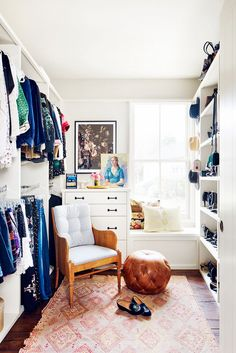 walk-in closet with narrow shoe shelves full & half height rods, dresser, all in white, great rug and armchair, window seat, in Brooklyn Decker's house, Austin, TX