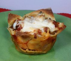 "These Lasagna Wonton ""Cupcakes"" are bursting with meaty, cheesy, saucy flavor. Just  165 calories or 5 Weight Watchers SmartPoints each! www.emilybites.com"