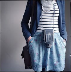 The cute outfit and the gorgeous camera :3