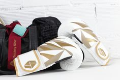 The Bia Boxing Gloves in white/gold.