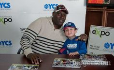 Giants fans gathered to meet former NY Giant Ottis Anderson, who stopped by the Electronics Expo store in Wayne for a charity event to benefit the children of Youth Consultation Service (YCS). The event was co-sponsored by Sony Electronics.