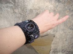 Bead embroidered bracelet black on the metal-based. by OPGDesign