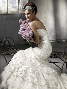 The entire look of this bride is breath taking. The purple roses look amazing.