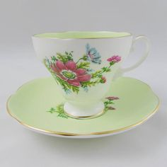 Foley tea cup and saucer, made in England. Tea cup is green inside, with flowers on the outside. Gold trimming on cup and saucer edges. In excellent condition (see photos). Markings read: Foley Bone China Made in England Please bear in mind that these are vintage items and there may be small imperfections from age or flaws from production. I try to make my photos as clear as possible and carefully examine and describe each item. Items are packed with care so that they arrive safely to yo...