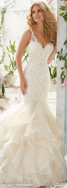 Mori Lee by Madeline Gardner Spring 2016 Wedding Dress.Vintage Pearl and Crystal Beading on Alencon Lace Appliques Over Chantilly Lace onto an Organza and Tulle Flounced Mermaid Gown