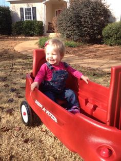 Enjoying a ride in my new red wagon.