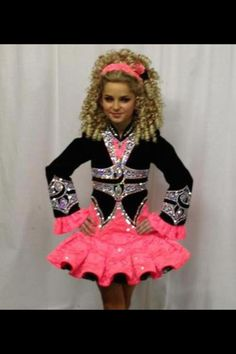 ss:  she likes this color pink and the black showing under the skirt.  also likes the poofy cuffs.