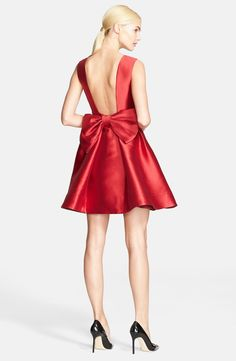 Ooh la la! The low back finished with a bow is breathtaking. This red Kate Spade fit & flare minidress is perfect for party season.
