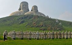 Terracotta Mongolian Warriors and a statue of Genghis Khan are seen at the recently completed Mount Khan tourist attraction in Holingol, Inner Mongolia