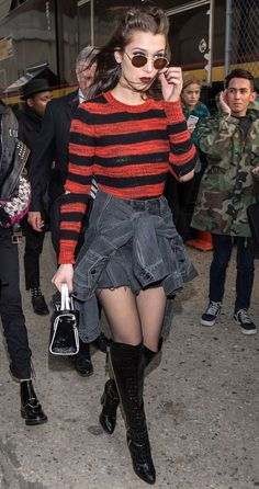 Best Model Off-Duty Outfits - Bella Hadid in a striped sweater, black distressed mini skirt, sheer tights and over-the-knee boots