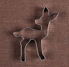 Use our baby deer cookie cutter to make sugar cookies! Bake them to enjoy or package up for sweet party favors for first birthdays or baby shower favors! We also carry a large selection of sprinkles, food coloring & frosting tips to decorate your cookies! COUNT: 1 metal cookie cutter SIZE: approx. 4.5 x 3.75  NOTE: To extend the life of your cookie cutters hand wash in hot soapy water immediately after use and allow to air dry before storing. Not dishwasher safe.  NEED MORE: Please contact…