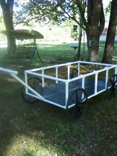 Yard Cart...made from pvc pipe and wheelChair wheels.