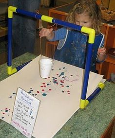 Pendulum Painting - I bet it's messy, but what a great way to teach gravity/centrifugal force!