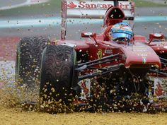 Fernando Alonso loses the steering in his Ferrari after his damaged front wing lodges underneath the monocoque and runs off at Turn 1 of the second lap of the Malaysian GP