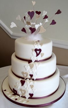 modern wedding cakes pictures | cascade of modern champagne, dusky plum and white hearts down a ...
