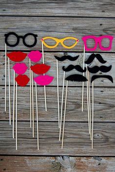 Mustache on a stick, Lips on a stick & Eye Glasses on a stick.
