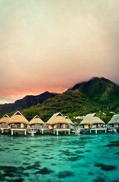 Bora Bora. It would be a dream come true to take a hubby & wifey vacation in a hut over the water with glass floors!!