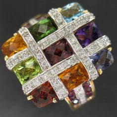 From the Bellari collection this is an 18k Yellow Gold ring with .29 carats total weight in diamonds and over 4 carats total in colored gemstones.