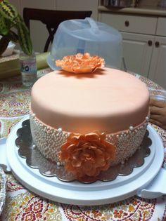 Fondant flowers and pearl ribbon cake