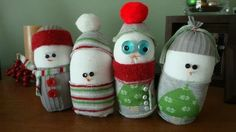 Best Snowman Crafts Ideas ~use cardboard tube & cover with a white sock... baby sock would work for the hat & clothes. Aren't they cute?!