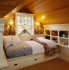 built in platform bed in attic, with storage underneath and lots of built-ins in...