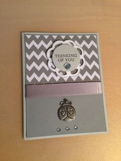 Gray zig zag paper on this card with added metal ladybug embellishment and swavorski crystals.