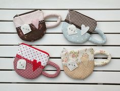 Tea cup mini bags- Tea cup mini bags I want to make these into mug rugs rather than bags. They're so precious. Fabric Crafts, Sewing Crafts, Sewing Projects, Diy Cadeau Noel, Tea Party Favors, Craft Bags, Mug Rugs, Sewing Hacks, Purses And Bags