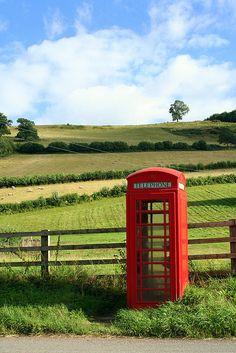Telephone box outside Skenfrith Castle, near Abergavenny, Wales http://ninbra.tumblr.com/post/3829738343/via-thingssheloves-telephone-box-outside