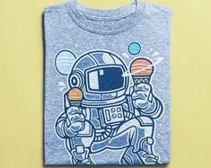 Items similar to Cool Astronaut Skater Shirt - Skateboard T-Shirt, Street Art Apparel, Unisex Clothing on Etsy Skater Shirts, T Shirts, Surf Shirt, African Safari, Street Art, Graffiti, Vintage Shirts, Tshirts Online, Vintage Designs