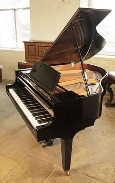 A 1987, Kawai GE-1 baby grand piano for sale with a black case and square, tapered legs at Besbrode Pianos. Piano has an eighty-eight note keyboard and a three-pedal lyre.