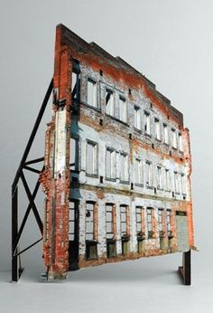 Israeli artist Ofra Lapid's Broken Houses series consists of incredibly detailed scale models based on photographs of abandoned barns, houses, and apartment buildings. Building facade