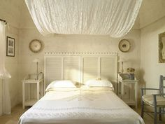 shutter headboard with tapestry canopy