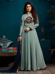 Jennifer winget style grey anarkali suit online which is crafted from silky georgette fabric with exclusive embroidery, bead work and stone work. This stunning bollywood anarkali suit comes with santoon bottom, santoon inner and chiffon dupatta.