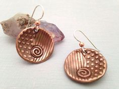 A personal favorite from my Etsy shop https://www.etsy.com/listing/260586403/dangle-earrings-with-copper-and-silver