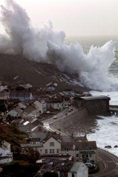 English coast as a terrifying wave crashes into it
