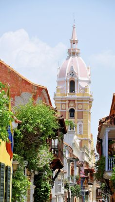 This is a picture of the Old Cathedral Tower in Colombia. The architecture in Colombia is historic. Tourists can take tours in cathedrals, private homes, and even military complexes.