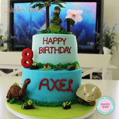 Beautiful dinosaur themed cake,This cake will have their kids roaring... of joy on your birthday!!! All dinosaurs were handmade using fondant and gumpaste, all edible.
