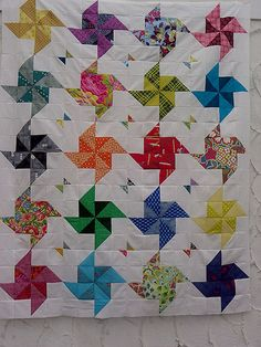 A pinwheel quilt by Little Island Quilting, via Flickr