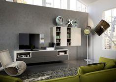 un tessuto di colore verde riveste il divano nel living realizzato con ALBINIA