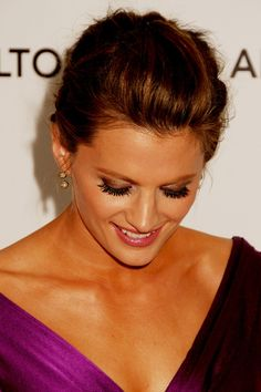 Stana with a shy smile. Love these.  And her lashes!  Tell me they're real . . .