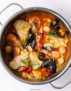 """Bouillabaisse - French Fish & Seafood Stew Soup This delicious seafood stew is a traditional fish stew originated from Marseille, the word """"bouillabasisse means to reduce heat, simmer, which is the exact the process for creating this awesome soup. Fish Recipes, Seafood Recipes, Cooking Recipes, Healthy Recipes, French Food Recipes, Slow Cooking, Seafood Stew, Fish And Seafood, Seafood Boil"""