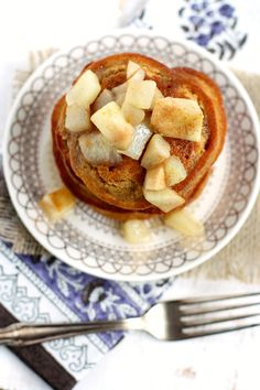 These gingerbread pancakes are the perfect holiday breakfast. Warmed pears and a sugar glaze make these vegan pancakes really special.