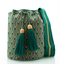 Exclusively designed Crossbody bags, tote bags, beach bags and accessories handmade by women of the Wayuu tribe in Colombia with a Fair Trade philosophy. Bucket Bag, Chair Socks, Tapestry Crochet Patterns, Tapestry Bag, Knitted Bags, Crochet Bags, Yarn Crafts, Purple And Black, Hand Knitting
